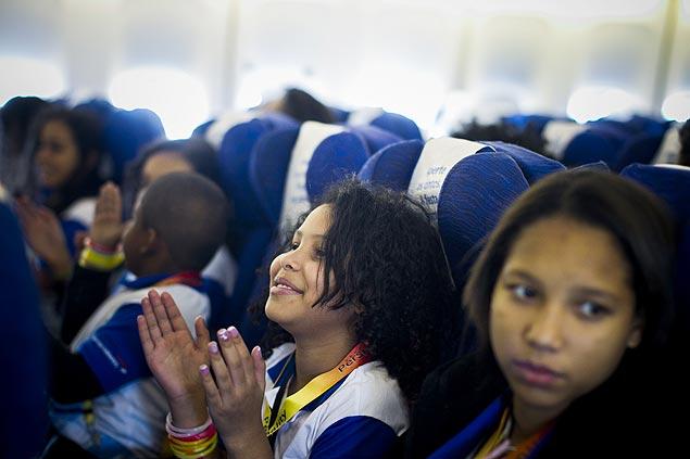 No ano passado, crianças carentes viajaram pela primeira vez de avião num voo da British (Leonardo Soares -13.out.2013/Folhapress)